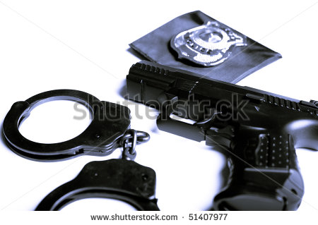 stock-photo-gun-handcuffs-and-police-badge-isolated-51407977